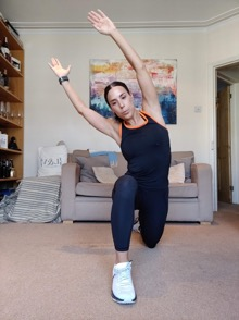 Runner's lunge with overhead lean - 3 Orangetheory Fitness Home Workouts