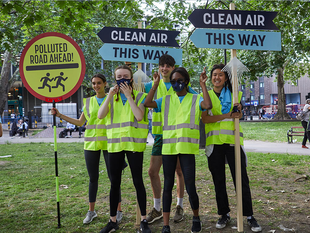 The Tenzing team direct runners to cleaner streets